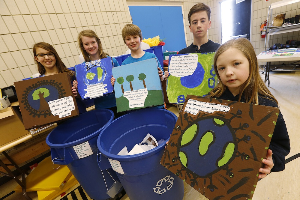 Members of the Earth Council Audrey, Emma, Alexander, Sam and Kelsey at Beaverlodge School in Winnipeg. Staff and students of Beaverlodge School won a STAPLES Recycle for Education Contest and were awarded $25,000 in computer equipment. Canadian Press Images/John Woods